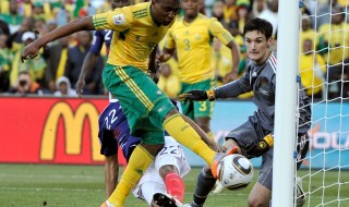 South Africa's Katlego Mphela, left, scores the team's second goal against France goalkeeper Hugo Lloris, right, during the World Cup group A soccer match between France and South Africa at Free State Stadium in Bloemfontein, South Africa, Tuesday, June 22, 2010.  (AP Photo/Martin Meissner)