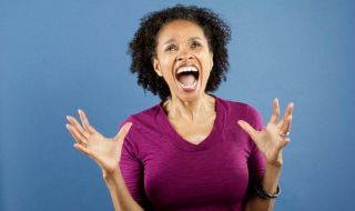 Mid adult woman screaming --- Image by © Jon Feingersh Photography/SuperStock/Corbis