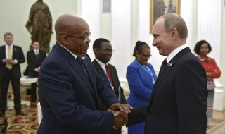 Russian President Vladimir Putin (R) shakes hands with South African President Jacob Zuma during their meeting at the Kremlin in Moscow, Russia, May 9, 2015. REUTERS/Alexei Nikolsky/RIA Novosti/Kremlin   ATTENTION EDITORS - THIS IMAGE HAS BEEN SUPPLIED BY A THIRD PARTY. IT IS DISTRIBUTED, EXACTLY AS RECEIVED BY REUTERS, AS A SERVICE TO CLIENTS - RTX1C9EX