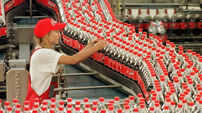 FILE - Sarina Krause checks bottles at the production line of the Coca-Cola plant in Genshagen, eastern Germany, in this Sept. 15, 1999 file picture. Jack L. Stahl, Coca-Cola's president and chief operating officer, resigned Sunday March 4, 2001 as the beverage giant announced a reorganization of its management structure.   (AP Photo/Sven Kaestner)