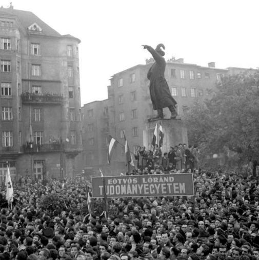 Gathering at the Józef Bem's statue. The sign says Lóránd University, Faculty of Arts