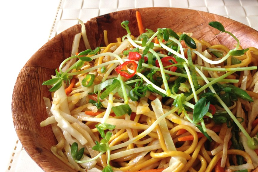 Pancit, egg noodles with veggies.