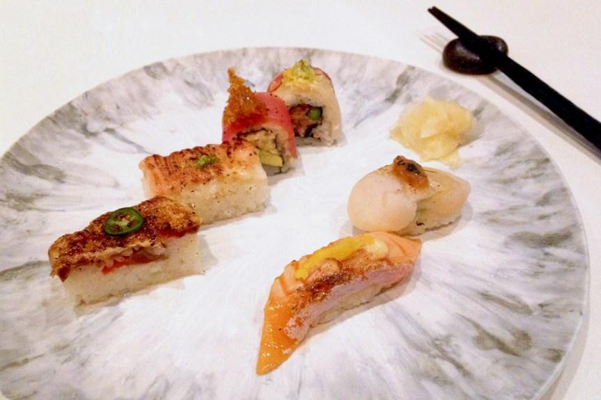 Aburi Oshi Sushi Selection, clockwise from left: Salmon Oshi, Ebi Oshi, Coal Harbour Roll, Queen's Quay Roll, Scallop Nigiri, Salmon Nigiri & pickled ginger on the side.