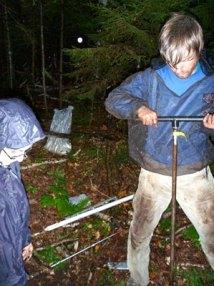 JP installing groundwater wells.