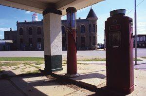 Abandoned gas station and closed bank, Howard, Kansas.