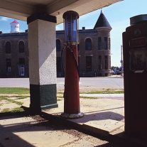 Abandoned gas station and closed bank, Howard, Kansas.