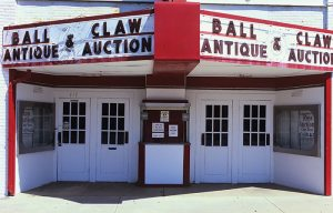 Auction house in Oswego, Kansas theater. There was at one time a lively business redistributing the old stuff left behind by a shrinking population. (click to enlarge)