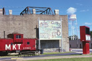 Mural, Oswego, Kansas. Even the art that recalls the triumphs of small town life are fading.