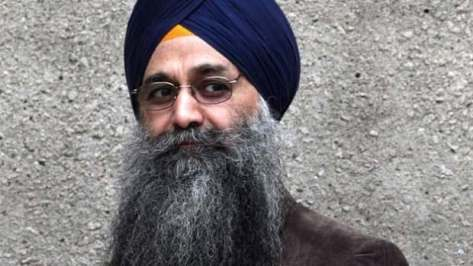 Inderjit Singh Reyat walks outside B.C. Supreme Court in Vancouver on Sept. 10, 2010.