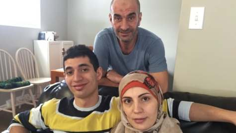 Ali Kharsa is shown with his parents, Ahmed and Doha, in their Saskatoon home.