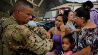 Puerto Rico still stumbles in the dark a month after Hurricane Maria