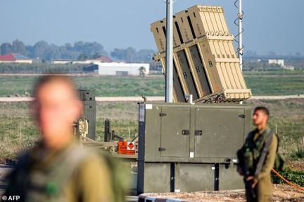 Israeli soliders patrol near an Iron Dome defence system, designed to intercept and destroy incoming short-range rockets and artillery shells, in the Israeli-annexed Golan Heights, in this picture taken on January 20, 2015
