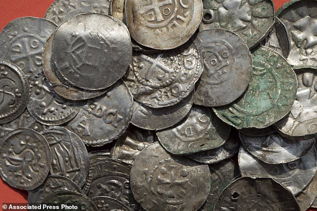Researchers said that around 100 silver coins from the collection (pictured) are probably from the reign of Bluetooth, who was the king of what is now Denmark, northern Germany, southern Sweden and parts of Norway.