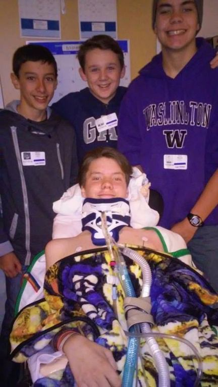 Hayden is pictured with friends during his stay in hospital. 'We think there are a lot more cases that the CDC admits to or have officially diagnosed. We have over 600 affected parents on our parents board,' Hayden's mom said