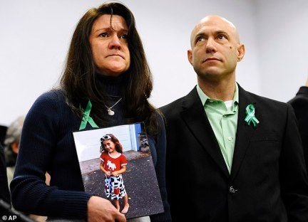 Richman founded and ran the Avielle Foundation - a violence prevention charity - with his wife Jennifer Hensel in honor of their daughter's death. They are pictured above just one month after the Sandy Hook massacre