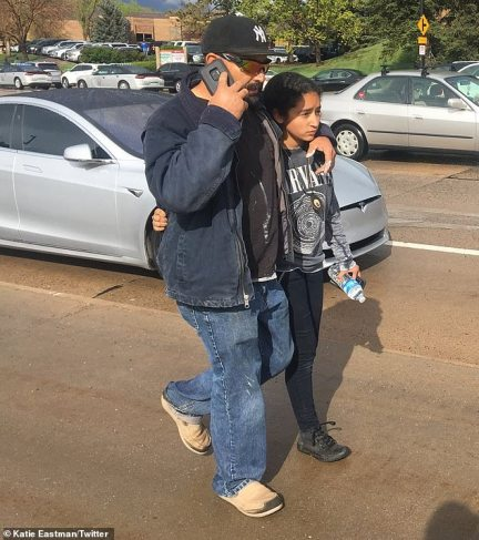 Fernando Montoya (above with his daughter) said that his 17-year-old son was shot three times but was expected to make a full recovery