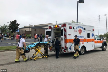 EMTs at the scene of a shooting at a Walmart in Mississippi on Tuesday after two people were shot dead by a disgruntled employee