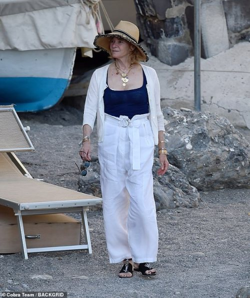 Chic: Steven's wife Kate - who he met on the set of 1984 film Temple of Doom, looked chic in a navy slip top, teamed with a white cardigan and flared trousers