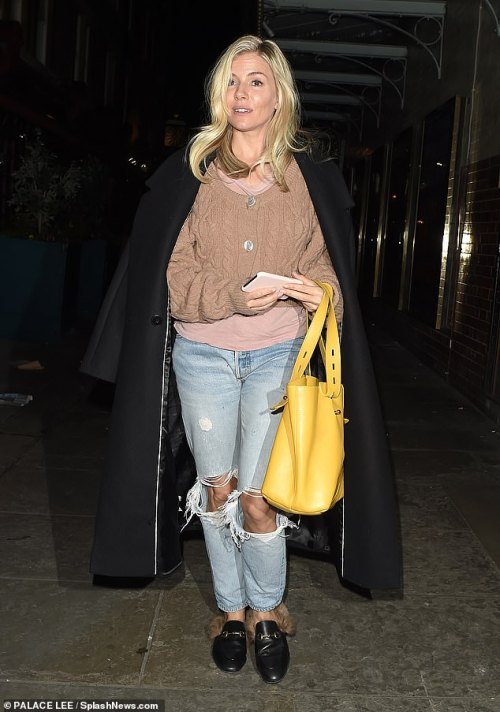 Ensemble: Sienna Miller, 37, cut a stylish figure on Friday evening as she went for a meal with Bruce and actor Robert De Niro after their appearance on The Graham Norton Show