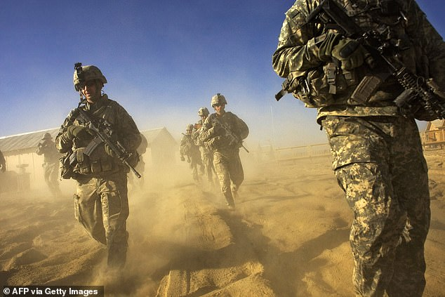US Army soliders from 1-506 Infantry Division set out on a patrol in Paktika province, situated along the Afghan-Pakistan border in November 2008