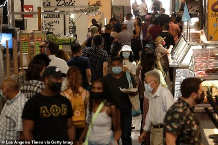 Diners mask up to visit Grand Central Market in Los Angeles. LA County has urged people to mask up again indoors amid a spike in COVID cases blamed on unvaccinated locals