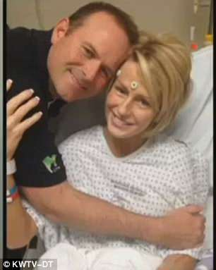 Rhonda Gossett, of Edmond, Oklahoma, said she believes CBD oil cured her of her stage four breast cancer. Pictured: Rhona with her husband, Darren
