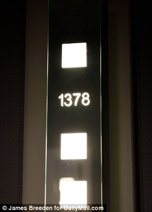Door numbers are  clearly visible and lit up in neon, placed to one side.
