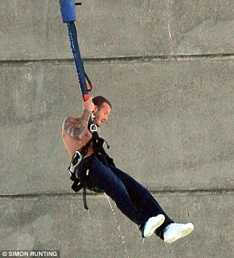 Beckham is hoisted skywards after his soaking