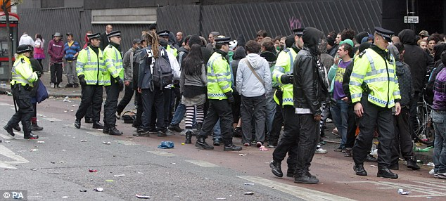 Unrest: Police calmed the crowds as hoards of tourists flocked to the building to witness the suspected illegal rave