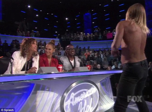 Look away now: Iggy approached the judges midway through his performance