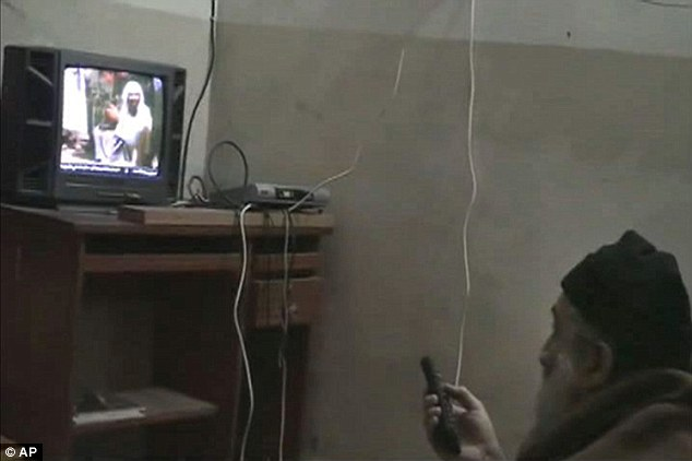 Image-obsessed: The footage also shows Bin Laden watching himself on the television