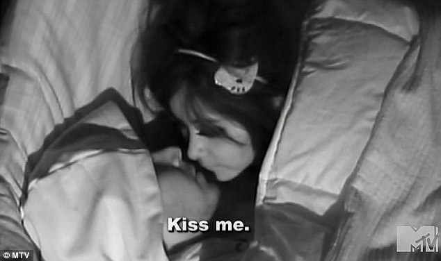Getting cosy: Snooki got between the sheets with Vinny in last night's episode of Jersey Shore following a heated row with her boyfriend Jionni