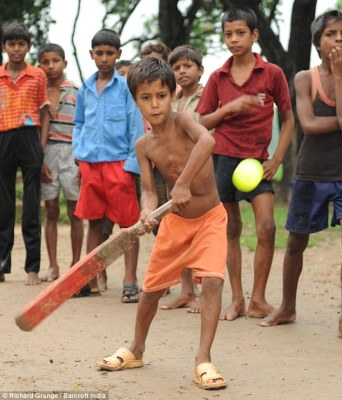Howzat? Deepak is able to fully indulge his love of cricket after the operation to remove his extra limbs