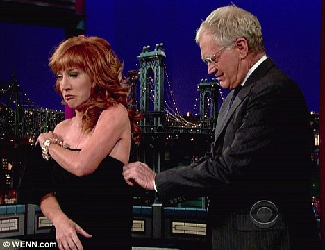 Helping hand: David helped the comedienne out of her dress as she vowed to strip once more