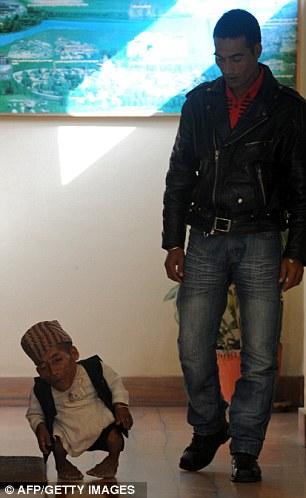 Chandra Bahadur Dangi walks with his nephew