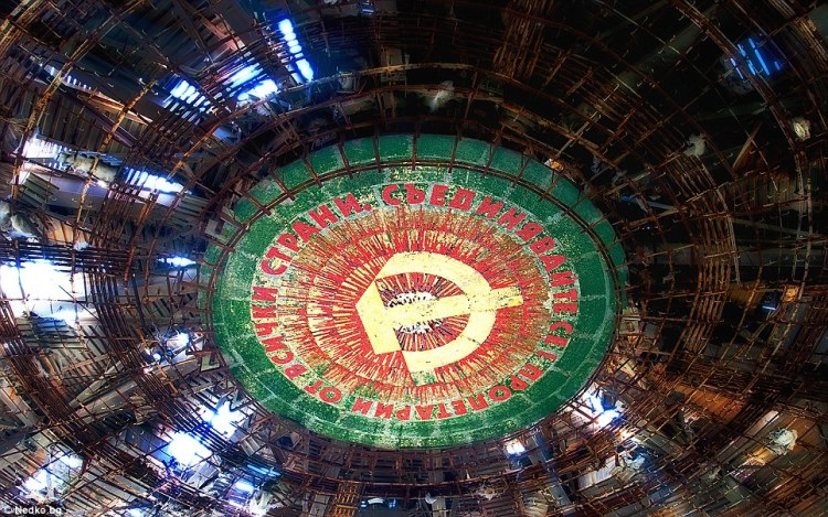 Glorious colours: The communist party's emblem still adorns the ceiling
