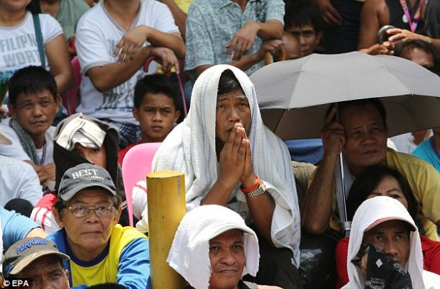 Disbelief: Pacquiao's hordes of fans in Marikina City, east of Manila cannot believe the result