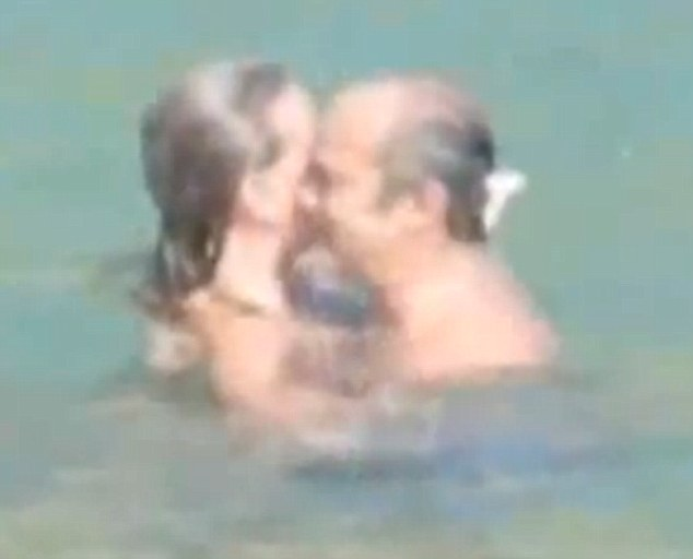 Old friends: Argentine priest Fernando María Bargallo, 59, was left red-faced after footage emerged of him swimming and cuddling with the blonde at a secluded luxury Mexican hideaway