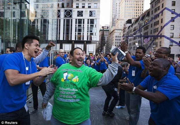 Celebration: Greg Parker leaves the Apple Store on 5th Avenue after buying the new Apple iPhone 5