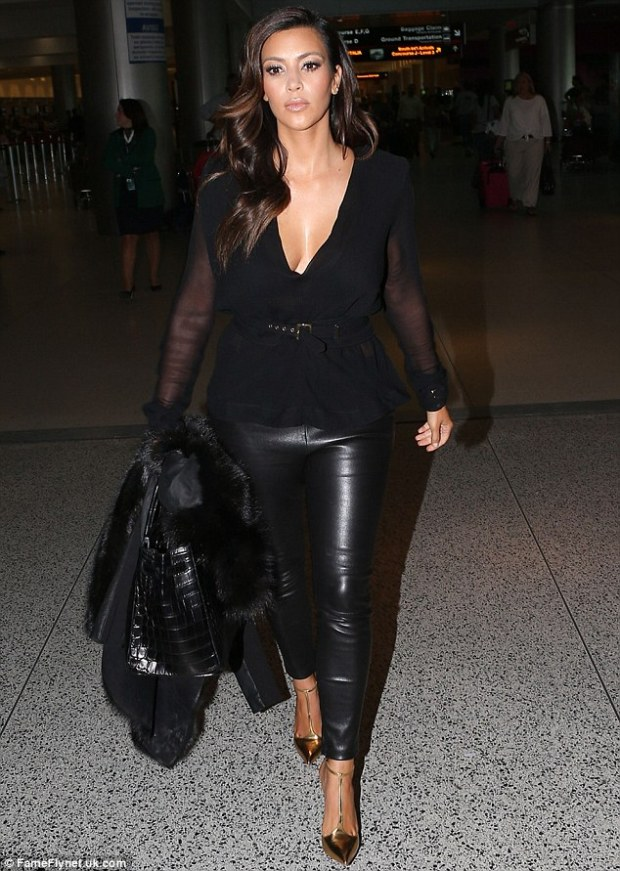 All poured in: Kim Kardashian arrived at Miami International Airport on Wednesday, poured into leather pants paired with gold stilettos