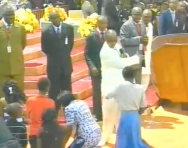 Caught on camera: Video of Mr Oyedepo striking a young 'witch' across the face in front of a congregation