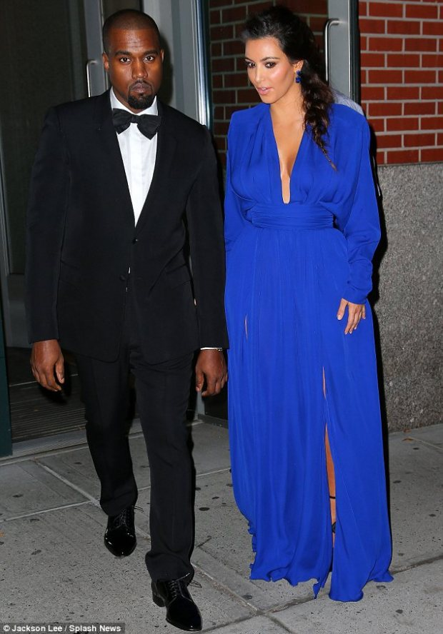 Cute couple: Kim and her beau Kanye West went arm in arm to the Angel Ball in New York on Monday