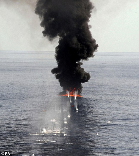 Royal Navy Frigate HMS Portland intercepts and disarms pirates in the Gulf of Aden in June 2009