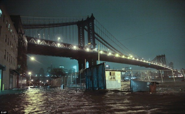 Water level: Streets are flooded under the Manhattan Bridge in the DUMBO (Down Under the Manhattan Bridge Overpass) section of Brooklyn, New York, on Monday night