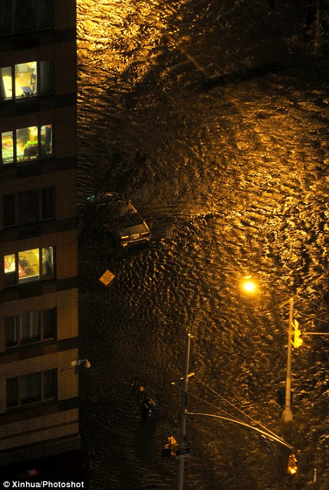 Photo taken on Oct. 29, 2012 shows a flooded street in Manhattan as Hurricane Sandy made its approach in New York