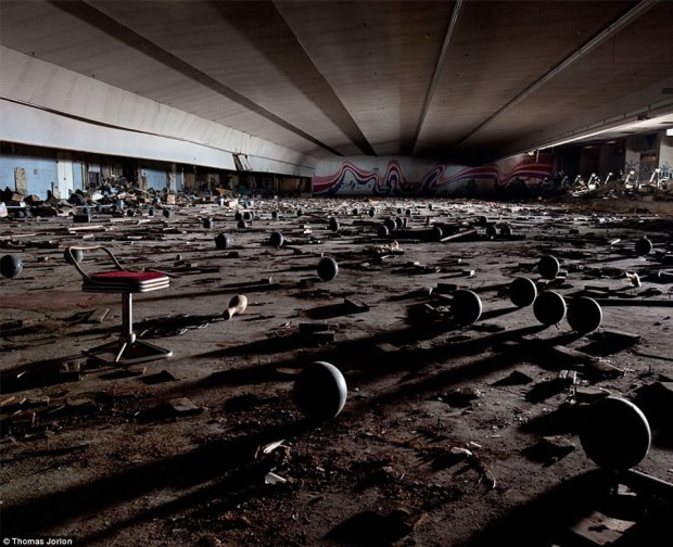 In ruins: A bowling alley lies littered with balls, pins and other debris more than 40 years after it was last used