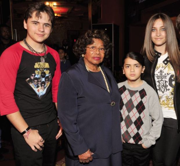Guardian: The three Jackson children with their grandmother Katherine who has been giving money she received from her son to other members of the family