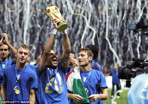 Wise choice: Simone Perrotta (lifting trophy) could have played for England, but chose Italy and won the 2006 World Cup