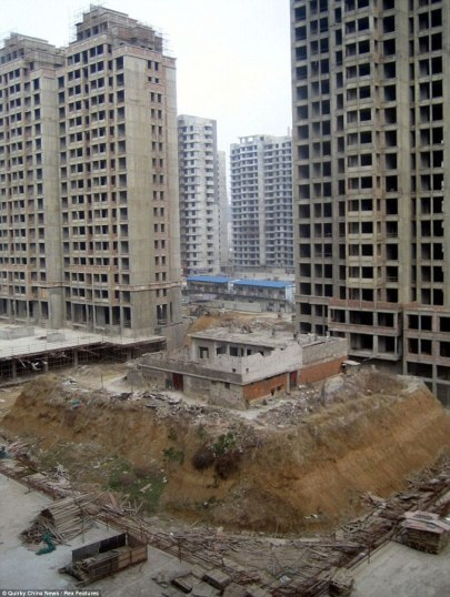 Isolated: Niu Chuangen and Zhang Zhongyun's home stands on a small parcel of land amid the growing skyscrapers