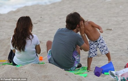 Big kiss for Mason: Scott planted a kiss on his son Mason's cheek